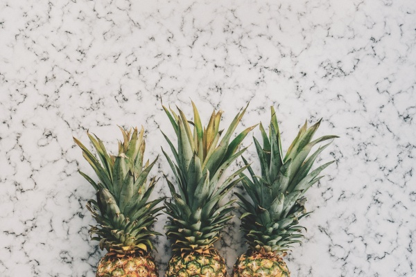 Pineapples against a marble surface