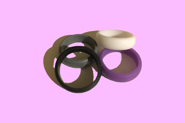 Silicone rings on pink background