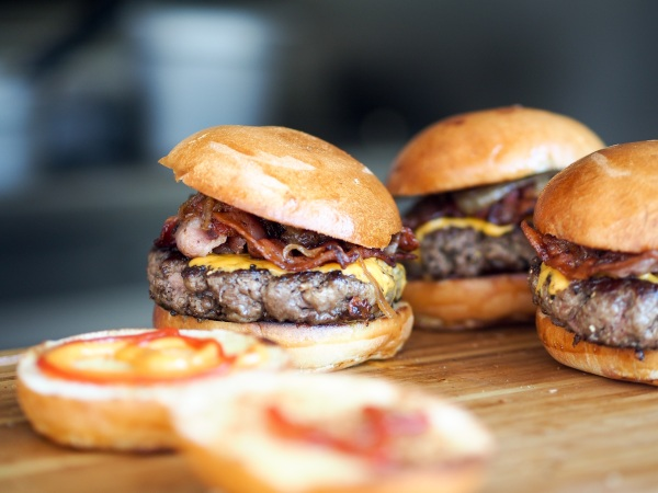 Burgers with bread buns on counter