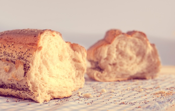 Bread stick broken in half on table