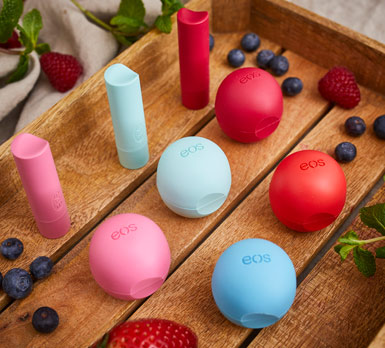 Eos chapstick on wooden counter top