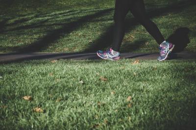 girl running along pavement in park