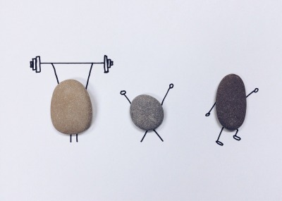 Little rocks holding weights and working out