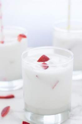 Coconut cooler drink in glass on table