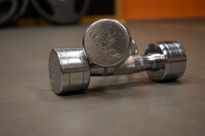 two dumbbells sitting on gym floor