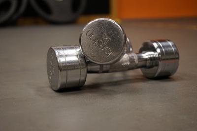 two dumbbells sitting on gym floor