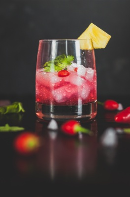 Glass with red punch and fruit garnish