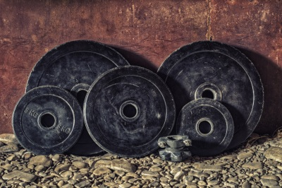 weight plates leaning against wall